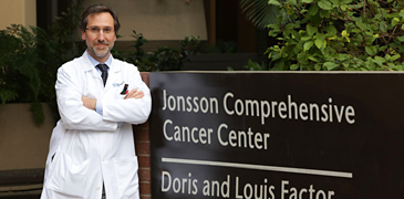 Dr. Antoni Ribas in Front of JCCC Sign